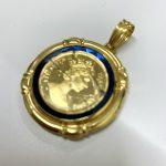 コインの枠に縁取りの装飾がされている金貨枠